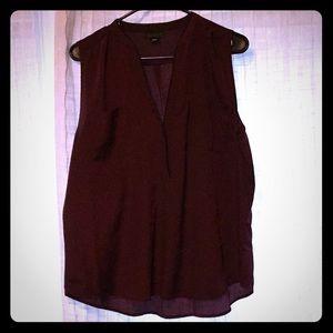Magenta colored sleeveless v neck blouse
